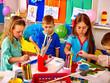 Group children learn painting in kindergarten. Happy childhood.