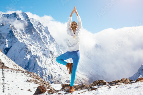 Yoga on mountain in winter