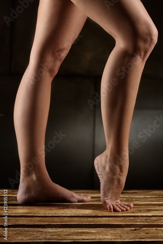Spoed Fotobehang Gymnastiek Closeup photo of naked female legs