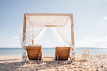 Paradise On The Beach Blue Sky And White Cloud And Ocean, Tent And сhaise Lounges For Beach Plain Relaxing. Beach Background. Summer Vacation Concept