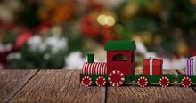 Composite Image Of Train Set With Gift Boxes