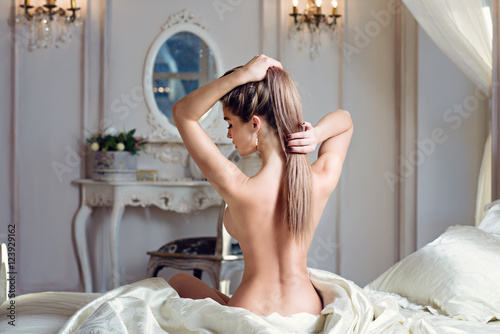 Deurstickers Ezel Beautiful nude sexy lady in elegant pose. Portrait of fashion model girl indoors. Beauty blonde woman with attractive buttocks. Close-up female ass and naked body
