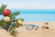 Christmas tree decorations on the beach in tropical. Concept of