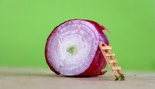 Red Onion Bulb On Wood Backgro...