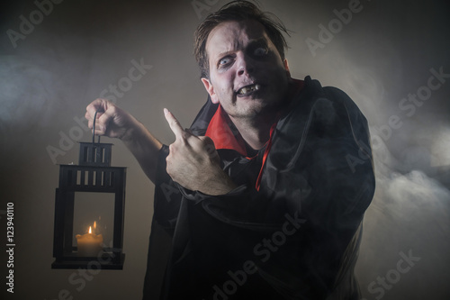 Fotografie, Obraz  vampire count Dracula waves his hand and shows a scary gesture