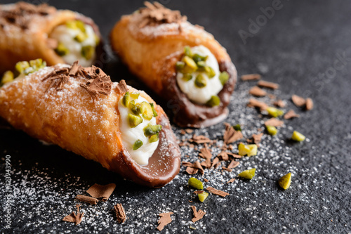 Canvas Print Traditional Sicilian cannoli stuffed with ricotta and pistachios