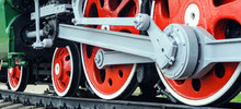 Front Locomotive View. Close-up Shoot Of Big Loco Wheels