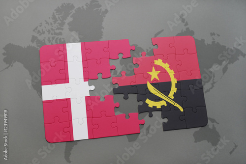 Photo  puzzle with the national flag of denmark and angola on a world map background