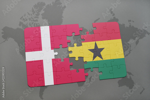 Photo  puzzle with the national flag of denmark and ghana on a world map background