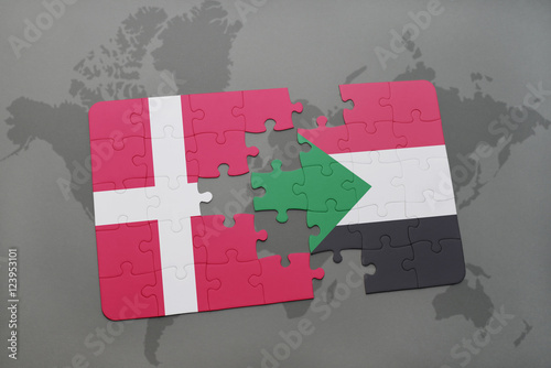 Photo  puzzle with the national flag of denmark and sudan on a world map background