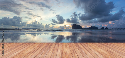Poster Zee / Oceaan Perspective of wood terrace against beautiful seascape at sunset