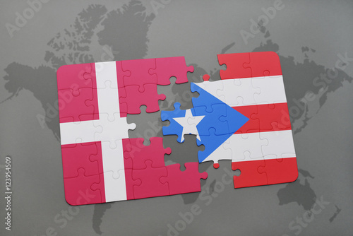 Photo  puzzle with the national flag of denmark and puerto rico on a world map background