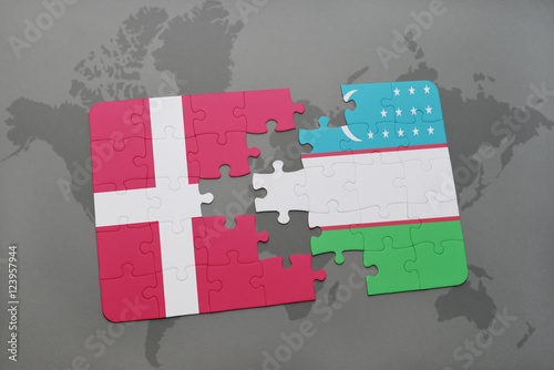 Photo  puzzle with the national flag of denmark and uzbekistan on a world map background