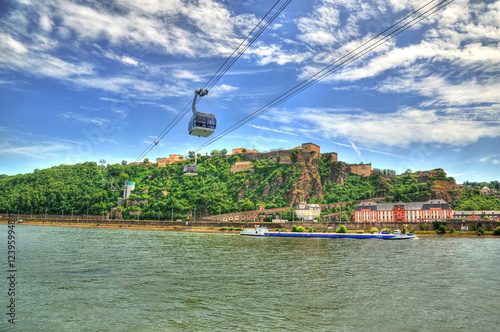 Foto  Beautiful HDR image of Fortress Ehrenbreitstein on the mountain in Koblenz over the Rhine river with cable cars moving through mountains