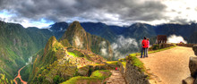 Panoramic HDR Image Of Tourists Observing The Machu Picchu, The Lost City Of The Incas On A Cloudy Day. Machu Picchu Is One Of The New 7 Wonder Of The Word Near Cusco, Peru