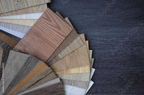 Obraz Laminate Wood Concept - Samples of laminate and vinyl floor tile on wooden Background wo - fototapety do salonu