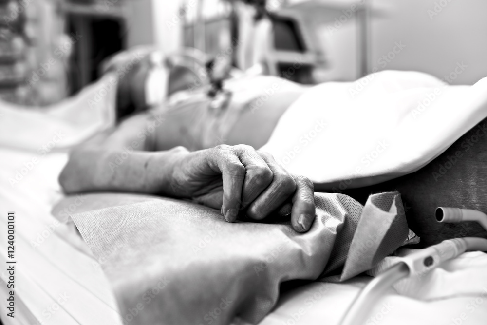Fototapeta Hand extremely exhausted patients dying in a hospital bed. Black