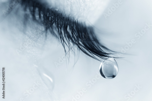 Fotomural Sad woman concept - closed eyelid closeup with a teardrop on eyelashes