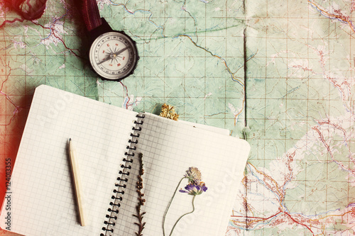 Obraz wanderlust and adventure concept, compass and notebook with wild - fototapety do salonu