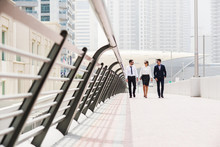 Business Colleagues Walking An...