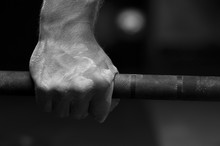 Closeup Of Male Hand Holding B...
