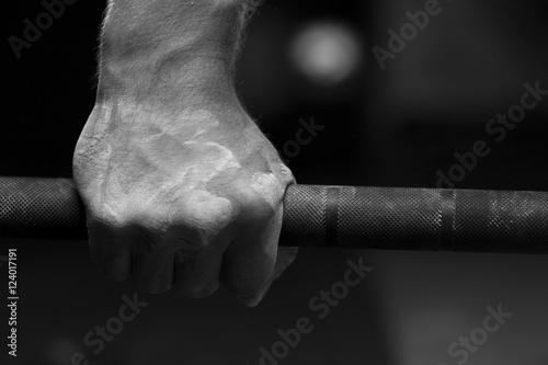 Closeup of male hand holding barbell Canvas Print