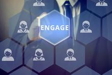 Businessman Touching 'ENGAGE' Word On Virtual Screen