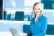 canvas print picture - Blond Businesswoman in Modern Office with Laptop Computer