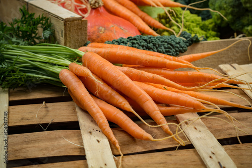 Keuken foto achterwand Groenten Green and orange fresh vegetables in wooden box, harvest