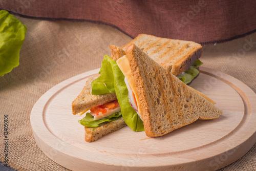 Staande foto Snack fresh sandwich on a wooden board with texture