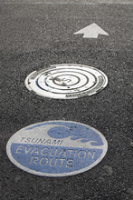 Tsunami Warning Signs On The Road With Arrow For Direction; Lincoln City, Oregon, United States Of America
