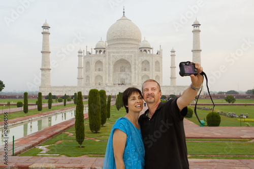 A Couple Takes A Picture Of Themselves With The Taj Mahal In The Background; Agra, Uttar Pradesh, India