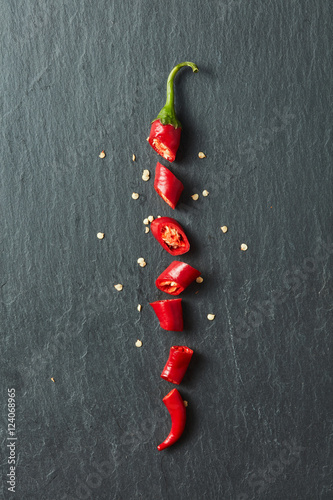 Photo  Red chili pepper cut into slices