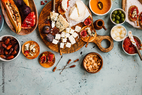 Canvas Prints Buffet, Bar Appetizers cheese platter. Party cheese platter with fruits, nuts and jams.