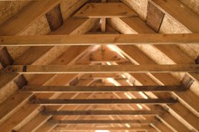 Interior View Of A Wooden Roof Structure.