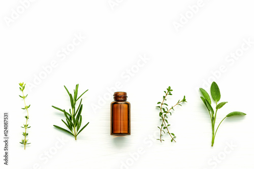 Canvas Prints Condiments Bottle of essential oil with fresh herbal sage, rosemary, lemon