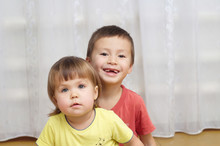 Sibling Sitting Together Indoor