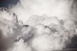 Leinwandbild Motiv Blue sky with white cumulus clouds. Toned