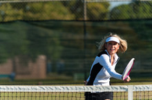 Attractive Blond Woman Playing Tennis At The Net On Sunny Morning