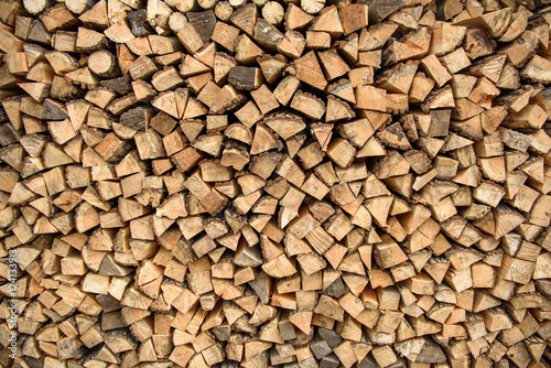 Photo Stands Firewood texture the wood stacked against the wall, rustic background