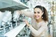 Adult woman choosing lighting units for interior