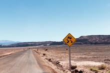 Slippery Road Sign In Atacama Desert.