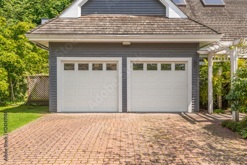 Fototapeta Luxury house with double garage door in Vancouver, Canada.