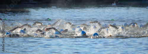 Triathlon swimmers in the river Ouse #124152334