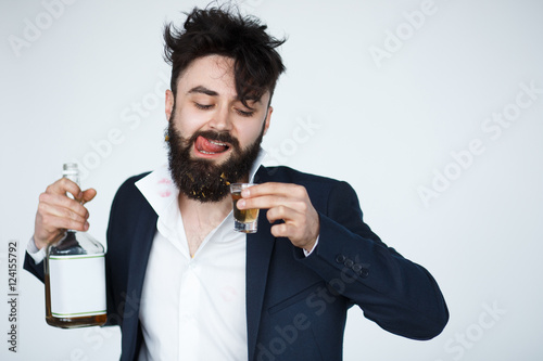 Fotografie, Obraz  Young man with beard is drunk