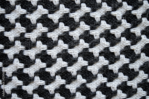 Photo  Bones / houndstooth knitted carpet background