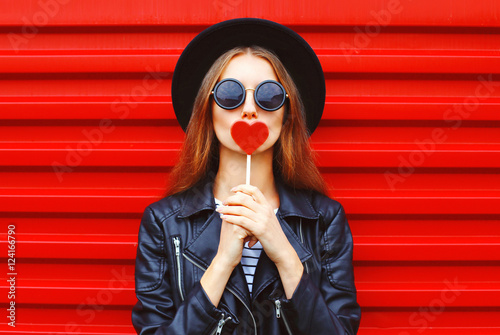 Fashion pretty young woman with red lollipop heart wearing black Poster Mural XXL
