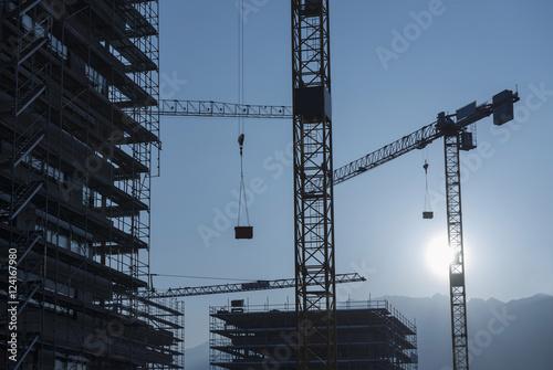 Cranes and scaffolding for building construction, Locarno, Ticino, Switzerland