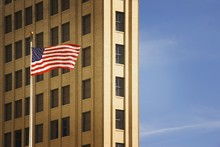 San Antonio, Texas, United States Of America; An American Flag In Front Of A Building