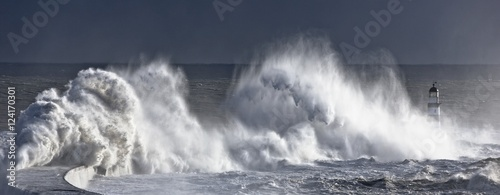 Waves crashing on lighthouse, Seaham, Teesside, England, UK